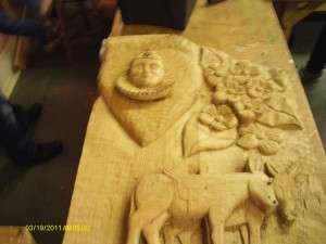 pierrits and donkeys carved on chair